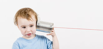 Child with tin can phone Royalty Free Stock Photo