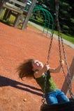Child on tire swing Stock Photo