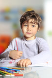 Child to color. With crayons Stock Images