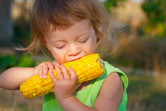 Child to eat boiled corncob Stock Photo