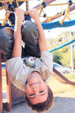 Child to play. Happy child to play in a playground Royalty Free Stock Images