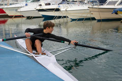 Child to rowing course Stock Photo