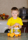 The child to wring out juice Royalty Free Stock Photography