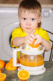 The child to wring out juice Stock Photos