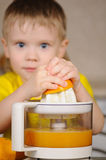 The child to wring out juice Royalty Free Stock Photos