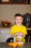 The child to wring out juice Stock Photo