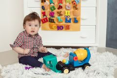 Funny baby toddler boy at home Royalty Free Stock Image
