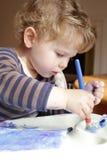Child, Toddler Drawing Art. Toddler boy, child, drawing, finger painting, making art Stock Image