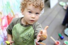 Child, Toddler Fingerpainting. Toddler boy, child, drawing, finger painting, making art Stock Image