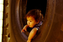 Child toddler inside big wheel Royalty Free Stock Photos