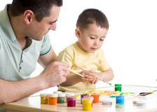 Child toddler painting in nursery at home Royalty Free Stock Photography