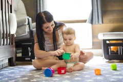 Child toddler playing toys at home or kindergarten with mother Stock Photo