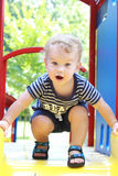 Child, Toddler Summer, Spring Playground. Child, toddler playing at an outdoor playground, park in summer or spring Stock Images