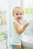 Child toddler washing hands with soap in bathroom Stock Photos