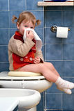 Child on the toilet Royalty Free Stock Image