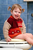 Child on the toilet Stock Images