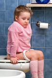 Child on the toilet Stock Photo