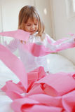 Child with toilet paper. Portrait of child playing with pink toilet paper royalty free stock photography