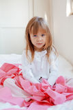 Child with toilet paper. Portrait of child playing with pink toilet paper royalty free stock image