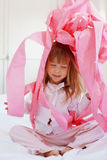 Child with toilet paper. Portrait of child playing with pink toilet paper royalty free stock photo