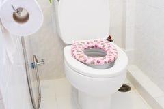 Child toilet seat. Pink child toilet seat on white toilet stock photography