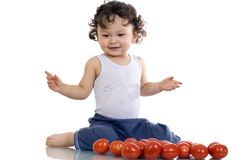 Child with tomato. royalty free stock photography