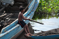 Child in the Tonle Sap lake in Cambodia Royalty Free Stock Images