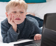 Child too young to look at chatroom Stock Image