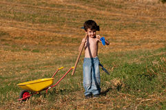 Child with tools for digging Royalty Free Stock Image
