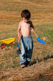 Child with tools for digging Stock Image
