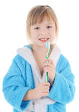 Child with toothbrush. Cheerful child with a toothbrush on white background Royalty Free Stock Image
