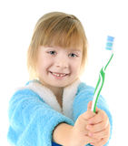 Child with toothbrush. Cheerful child with a toothbrush on white background Royalty Free Stock Images
