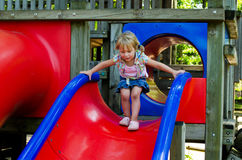 child at top of slide Stock Photo