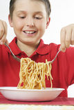 Child tossing pasta Royalty Free Stock Photos