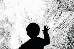 Child touch the big screen. Child hand touches on the glass. Black and white photo stock photos