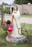 Child touches Mary the Mystical Rose Royalty Free Stock Image