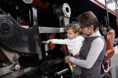 Child touching locomotive Stock Image