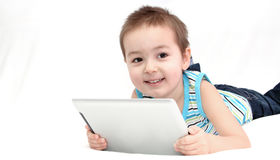 Child with touchpad Royalty Free Stock Photography