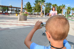 Child tourist photographing a park with compact camera Stock Image