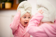 Child with towel on head Royalty Free Stock Image