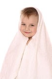 Child at towel is smiling royalty free stock photography