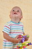 The child with a toy Royalty Free Stock Image
