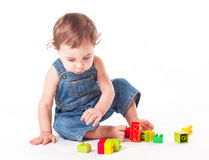 Child with a toy. Baby playing with color blocks isolated on white Royalty Free Stock Image