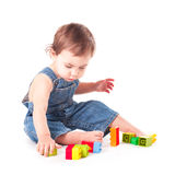 Child with a toy. Baby playing with color blocks isolated on white Royalty Free Stock Images