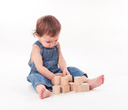 Child with a toy. Baby playing with wooden pyramid isolated on white Stock Images