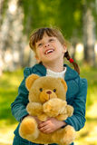 Child with toy bear cub Royalty Free Stock Image