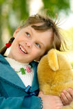 Child with toy bear cub Royalty Free Stock Photos