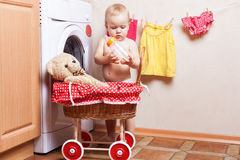 Child and toy bear Stock Photos