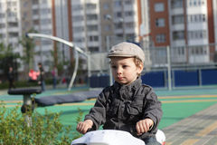 Child on toy bike Stock Photos