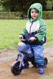 Child on toy bike Stock Images